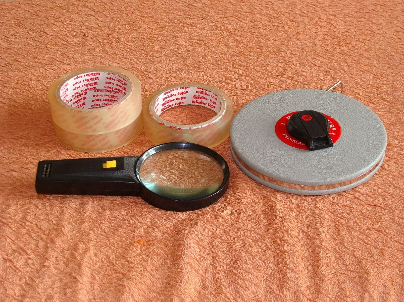 Lens, Measuring Tape and Adhesive Tape