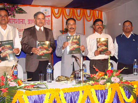 Shri Neyaz Ahmad, I.P.S, DGP (Vig.) releasing the Souvenir with other senior police officers